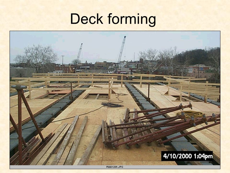 Deck forming FOR THOSE THAT HAVE NOT BEEN TO CONSTRUCTION SITE Hangers support wood joist/stringers timbers that plywood sit on.