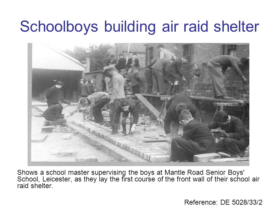 Schoolboys building air raid shelter