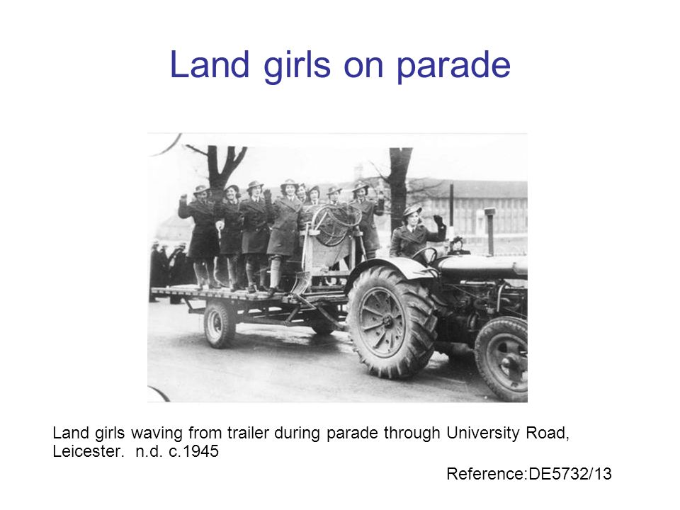 Land girls on parade Land girls waving from trailer during parade through University Road, Leicester. n.d. c.1945.