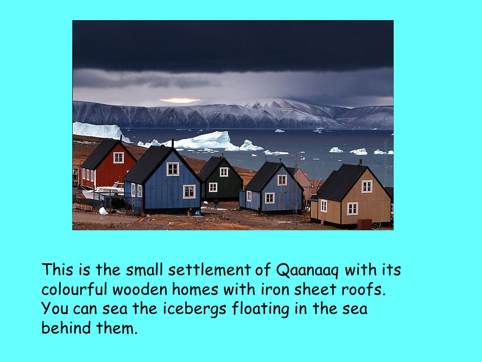This is the small settlement of Qaanaaq with its colourful wooden homes with iron sheet roofs.