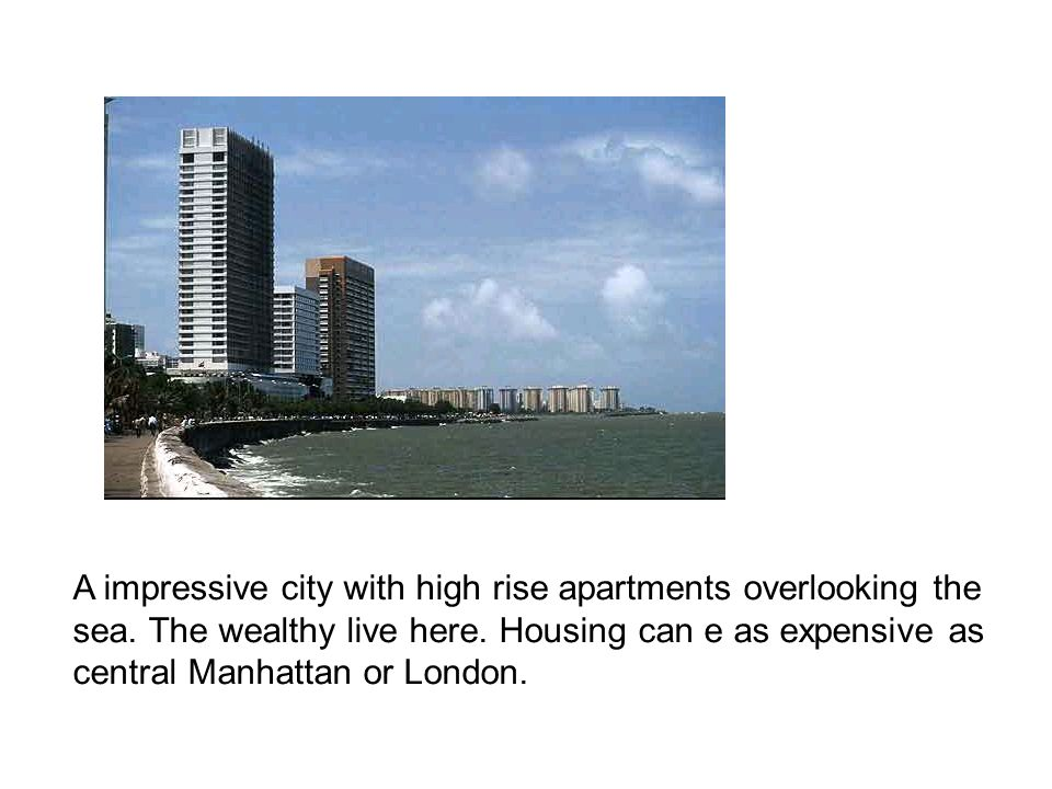 A impressive city with high rise apartments overlooking the sea