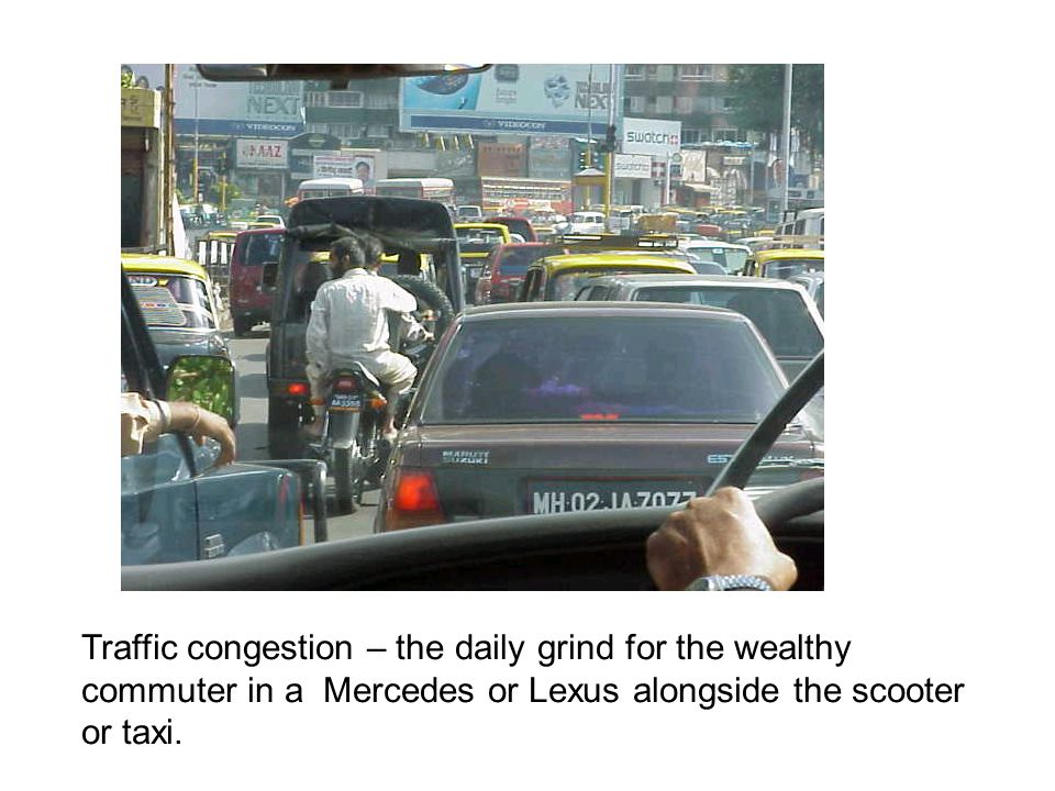 Traffic congestion – the daily grind for the wealthy commuter in a Mercedes or Lexus alongside the scooter or taxi.