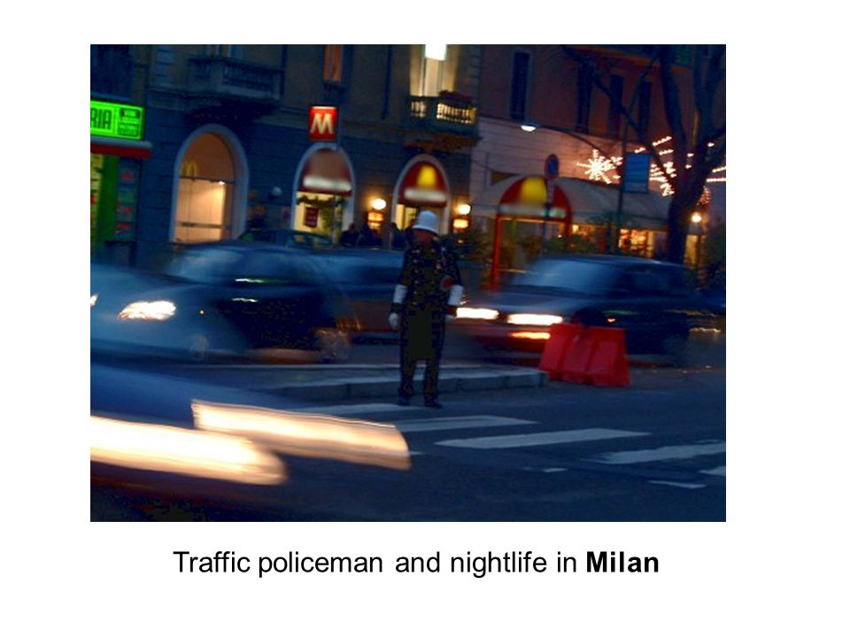 Traffic policeman and nightlife in Milan