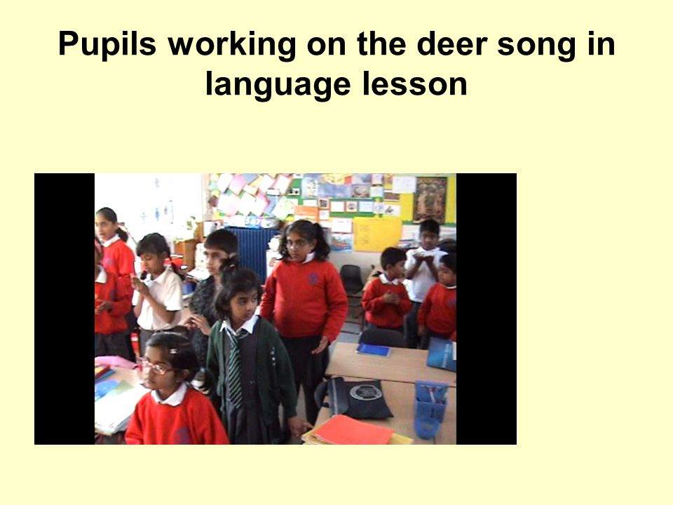 Pupils working on the deer song in language lesson