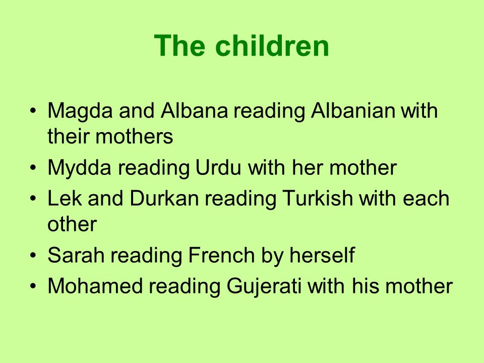 The children Magda and Albana reading Albanian with their mothers