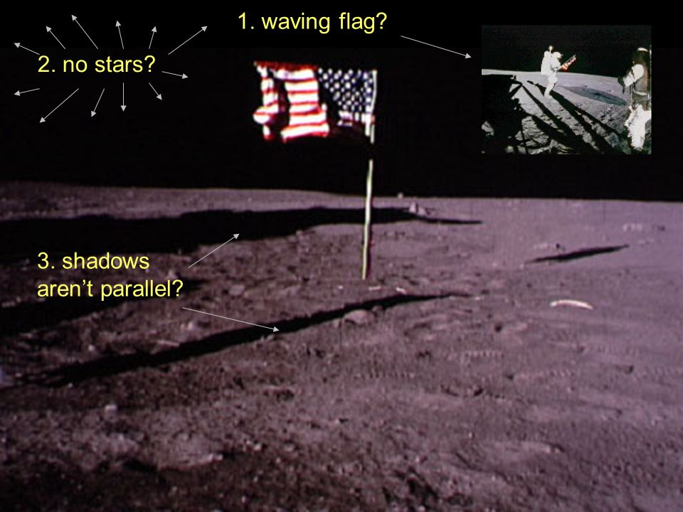 1. waving flag 2. no stars 3. shadows aren't parallel 3. shadows aren't parallel