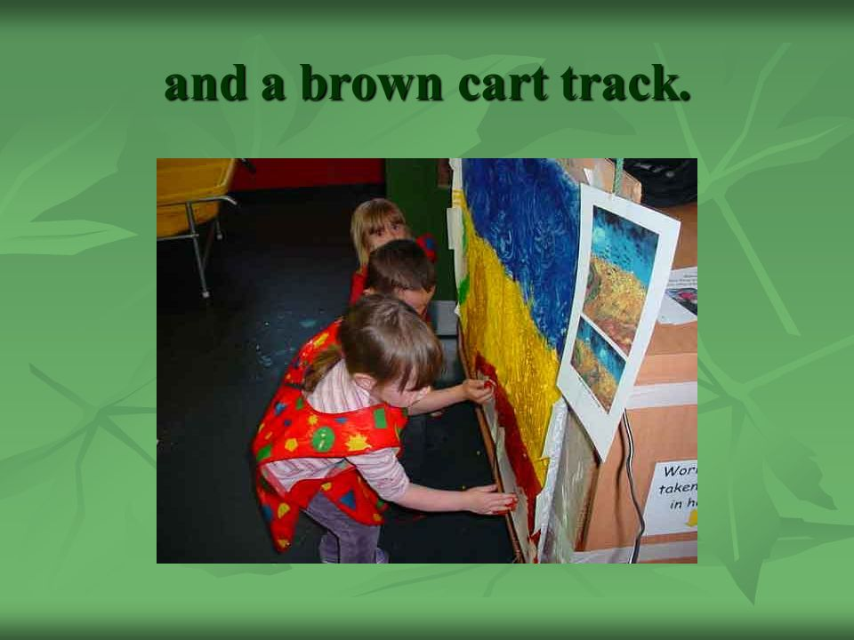 and a brown cart track.