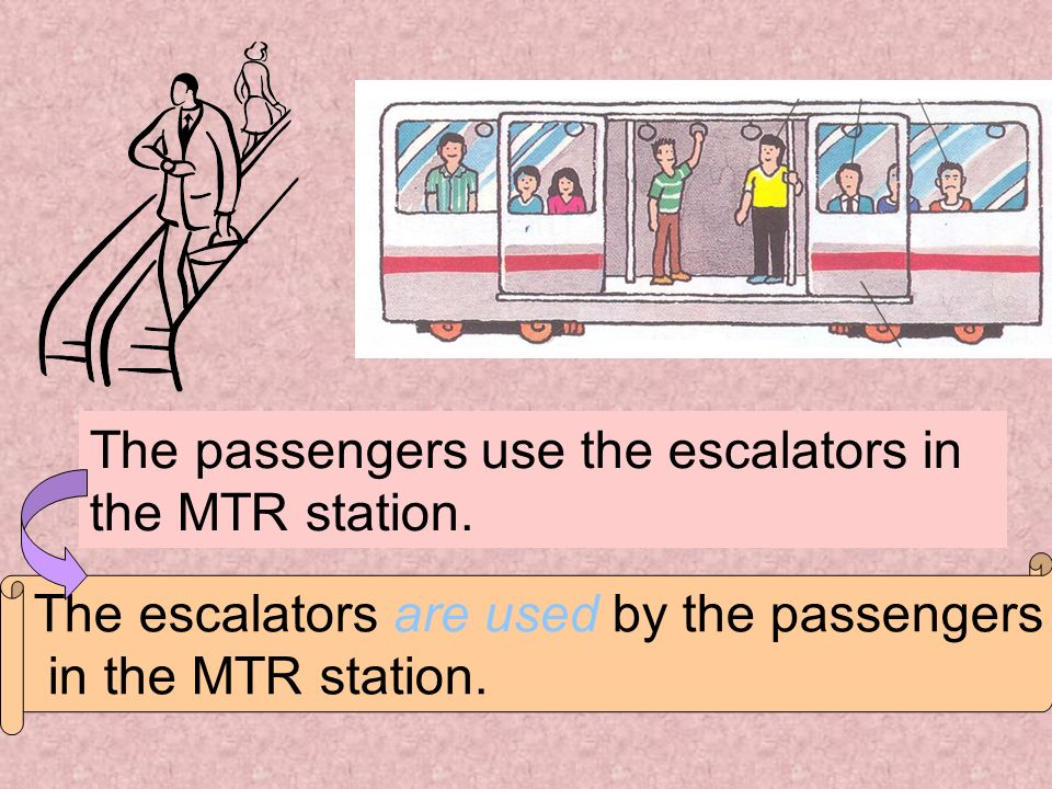 The passengers use the escalators in the MTR station.