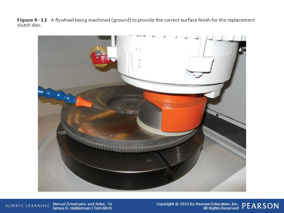 Figure 4–12 A flywheel being machined (ground) to provide the correct surface finish for the replacement clutch disc.