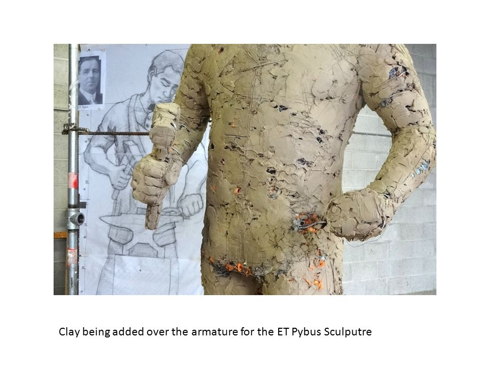 Clay being added over the armature for the ET Pybus Sculputre