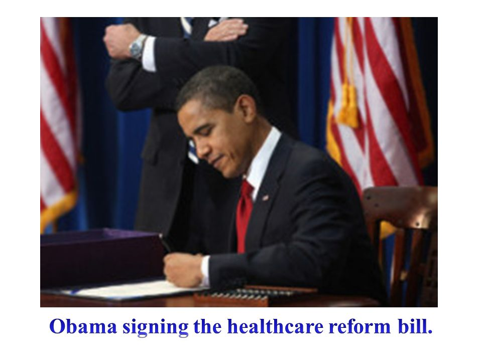 Obama signing the healthcare reform bill.