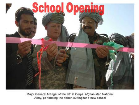 Major General Mangal of the 201st Corps, Afghanistan National Army, performing the ribbon cutting for a new school.