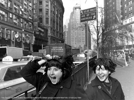 Two fans try out their Beatles wigs in anticipation of the British group's arrival in New York, 6 February 1964.