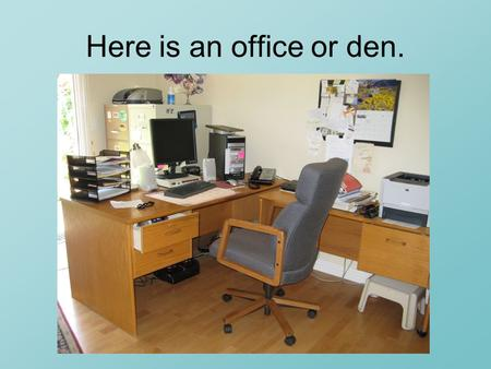 Here is an office or den.. You see a desk with computer on top and a big chair.