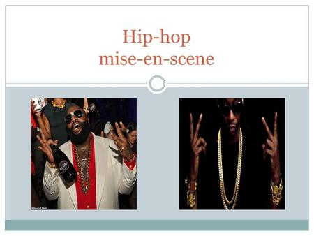 Hip-hop mise-en-scene. The 'rapper style' is characterised with a lot of flashy and ostentatious apparel. This might be because all rappers are considered.