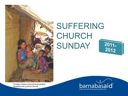 Christian children sit amid the devastation caused by the cyclone in Burma SUFFERING CHURCH SUNDAY.