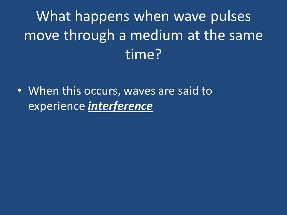 What happens when wave pulses move through a medium at the same time