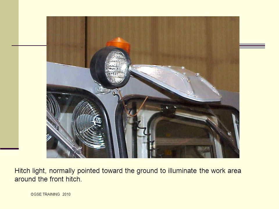 Hitch light, normally pointed toward the ground to illuminate the work area around the front hitch.