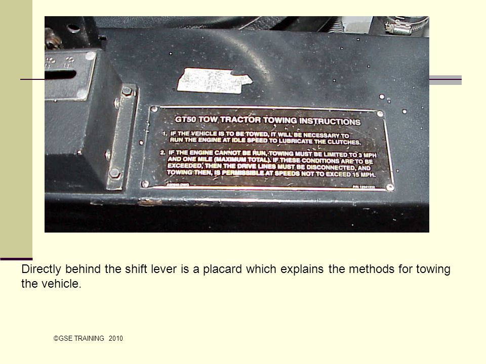 Directly behind the shift lever is a placard which explains the methods for towing the vehicle.