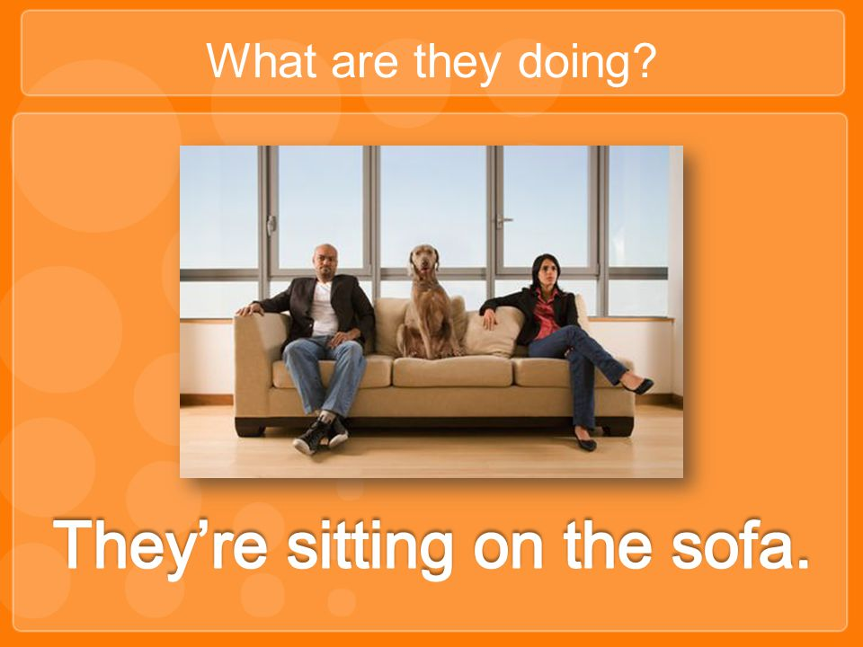 They're sitting on the sofa.