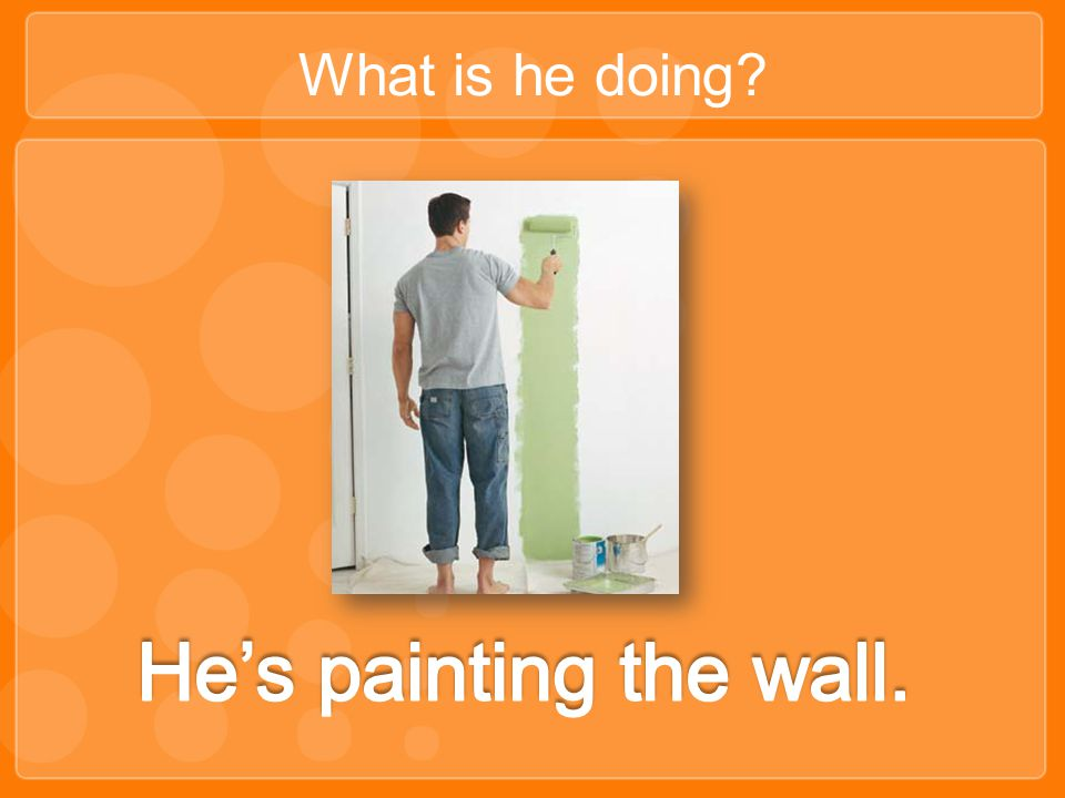 What is he doing He's painting the wall.
