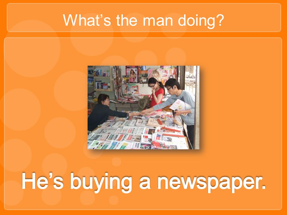 He's buying a newspaper.