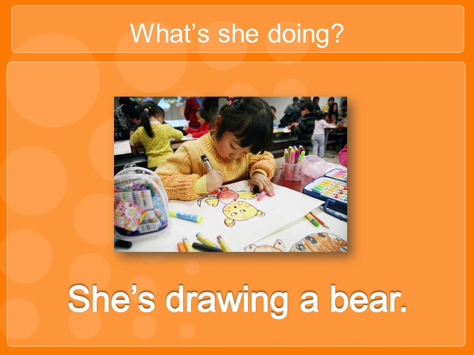 What's she doing She's drawing a bear.