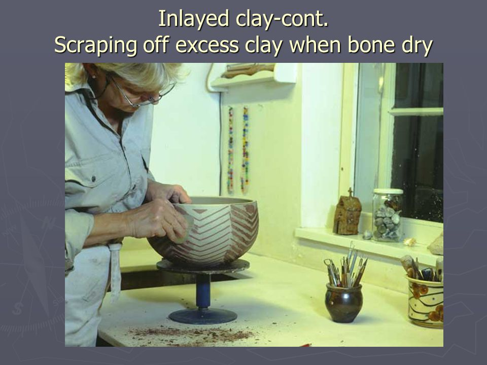 Inlayed clay-cont. Scraping off excess clay when bone dry