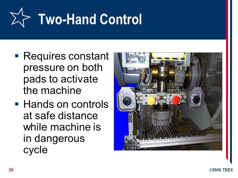 Two-Hand Control Requires constant pressure on both pads to activate the machine.
