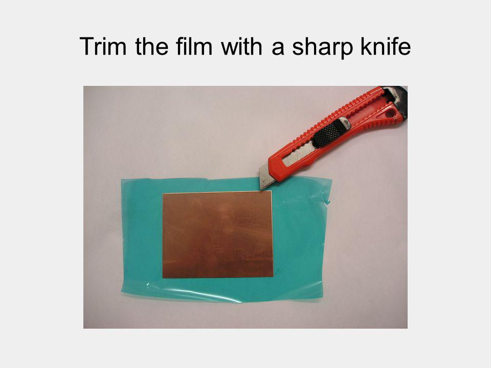 Trim the film with a sharp knife