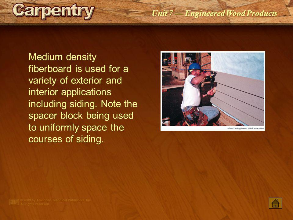Medium density fiberboard is used for a variety of exterior and interior applications including siding. Note the spacer block being used to uniformly space the courses of siding.