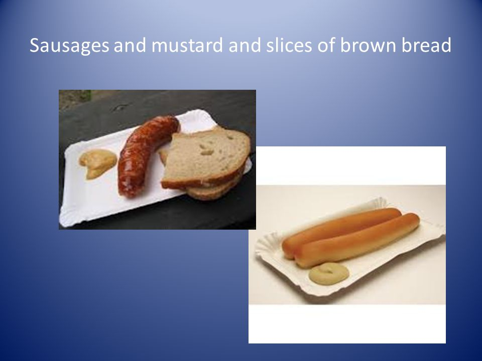 Sausages and mustard and slices of brown bread