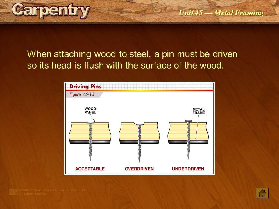 When attaching wood to steel, a pin must be driven so its head is flush with the surface of the wood.