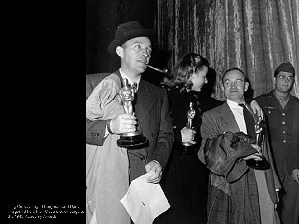 Bing Crosby, Ingrid Bergman and Barry Fitzgerald hold their Oscars back stage at the 1945 Academy Awards