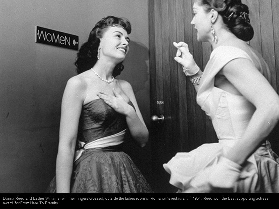 Donna Reed and Esther Williams, with her fingers crossed, outside the ladies room of Romanoff s restaurant in 1954.