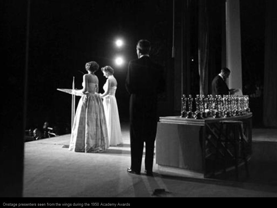 Onstage presenters seen from the wings during the 1950 Academy Awards