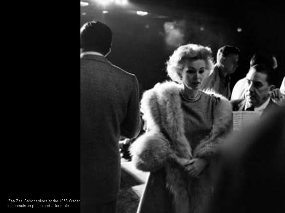 Zsa Zsa Gabor arrives at the 1958 Oscar rehearsals in pearls and a fur stole