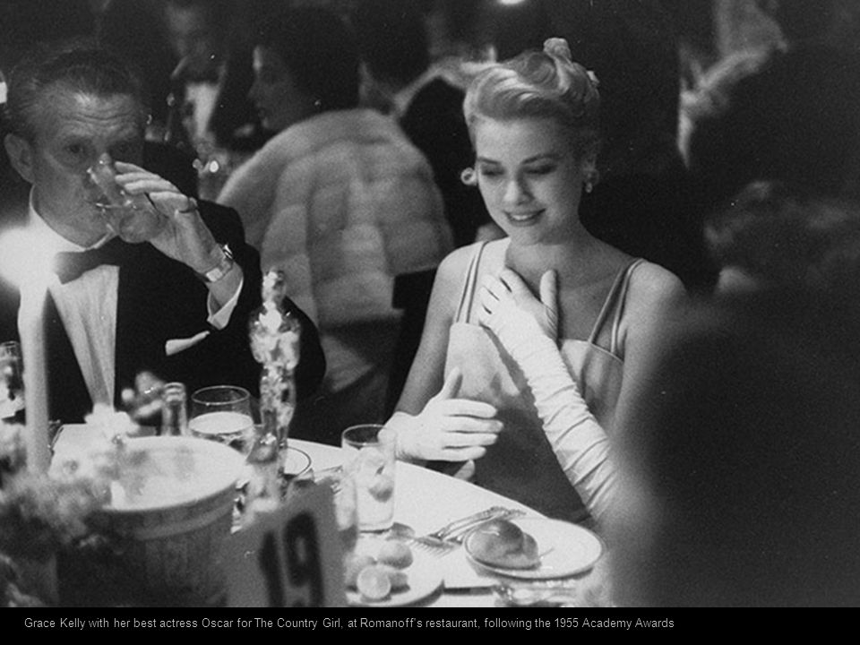 Grace Kelly with her best actress Oscar for The Country Girl, at Romanoff s restaurant, following the 1955 Academy Awards