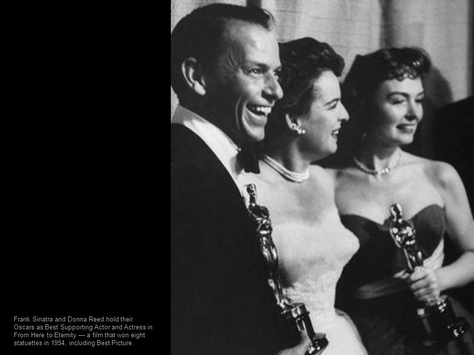 Frank Sinatra and Donna Reed hold their Oscars as Best Supporting Actor and Actress in From Here to Eternity — a film that won eight statuettes in 1954, including Best Picture.