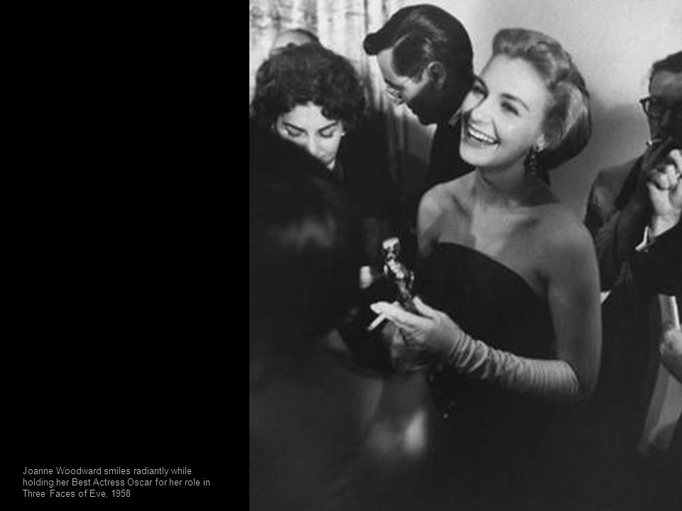 Joanne Woodward smiles radiantly while holding her Best Actress Oscar for her role in Three Faces of Eve, 1958