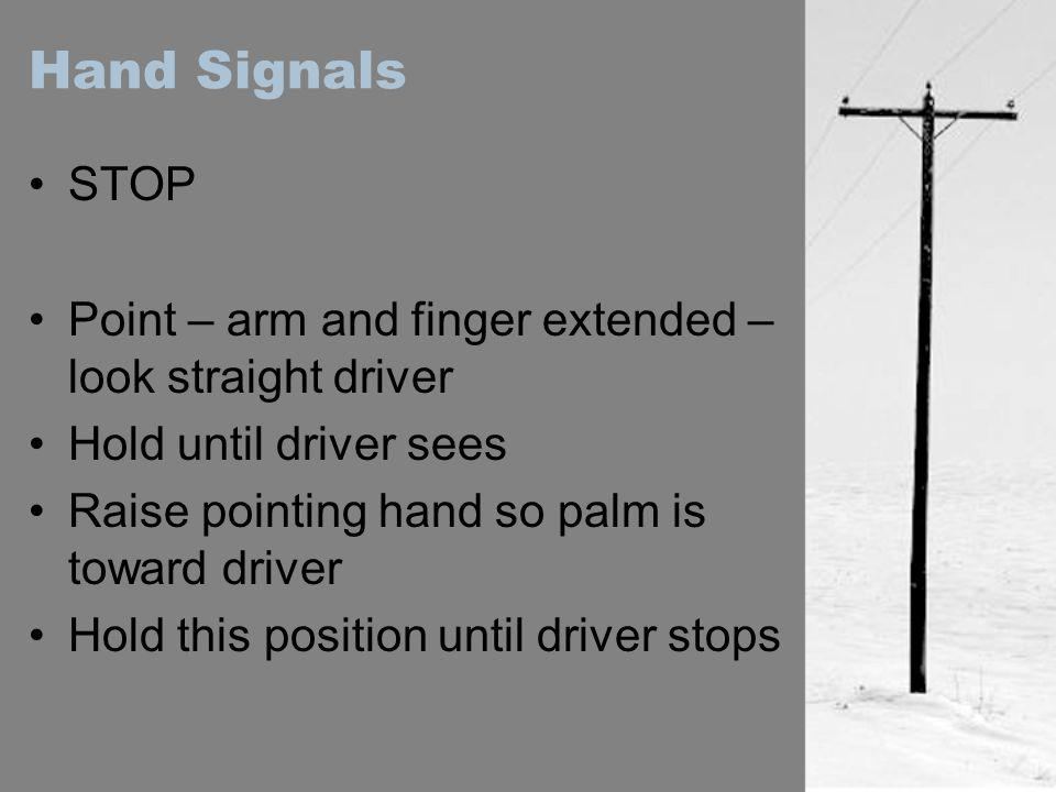 Hand Signals STOP. Point – arm and finger extended – look straight driver. Hold until driver sees.