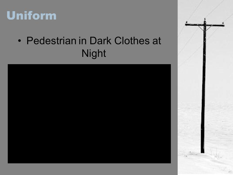 Pedestrian in Dark Clothes at Night