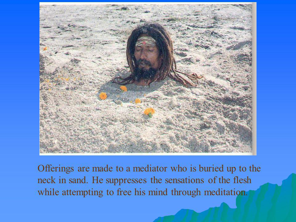 Offerings are made to a mediator who is buried up to the neck in sand