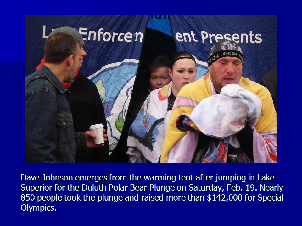 Dave Johnson emerges from the warming tent after jumping in Lake Superior for the Duluth Polar Bear Plunge on Saturday, Feb.