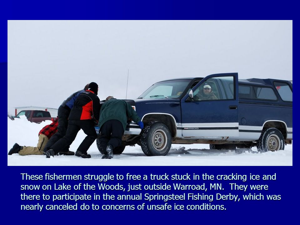 These fishermen struggle to free a truck stuck in the cracking ice and snow on Lake of the Woods, just outside Warroad, MN. They were there to participate in the annual Springsteel Fishing Derby, which was nearly canceled do to concerns of unsafe ice conditions.