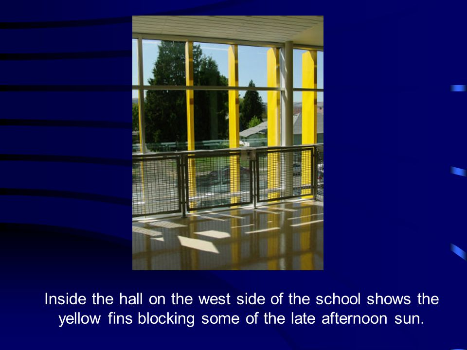 Inside the hall on the west side of the school shows the yellow fins blocking some of the late afternoon sun.