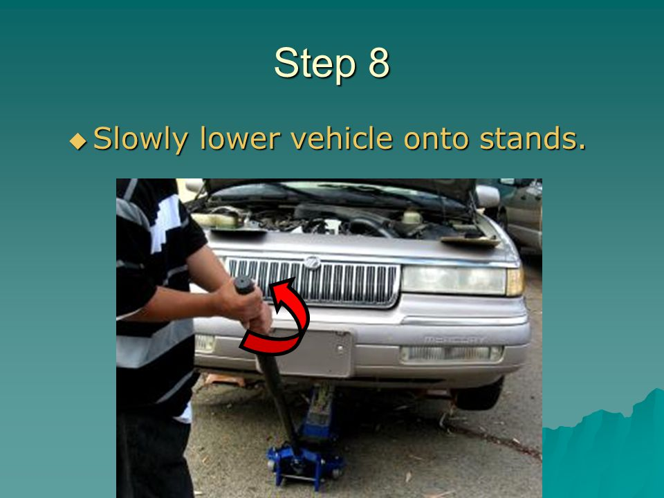 Step 8 Slowly lower vehicle onto stands.
