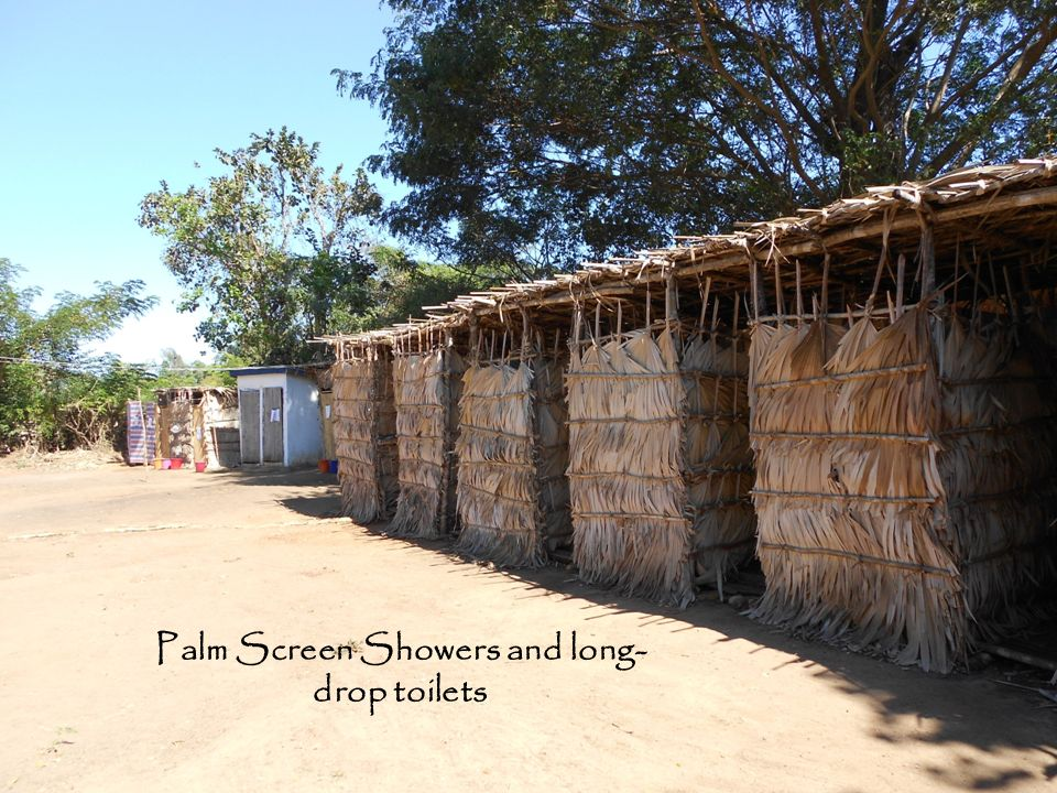 Palm Screen Showers and long-drop toilets Mariarano Village Camp