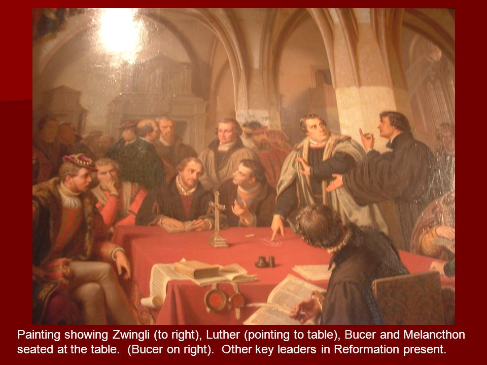 Painting showing Zwingli (to right), Luther (pointing to table), Bucer and Melancthon seated at the table.