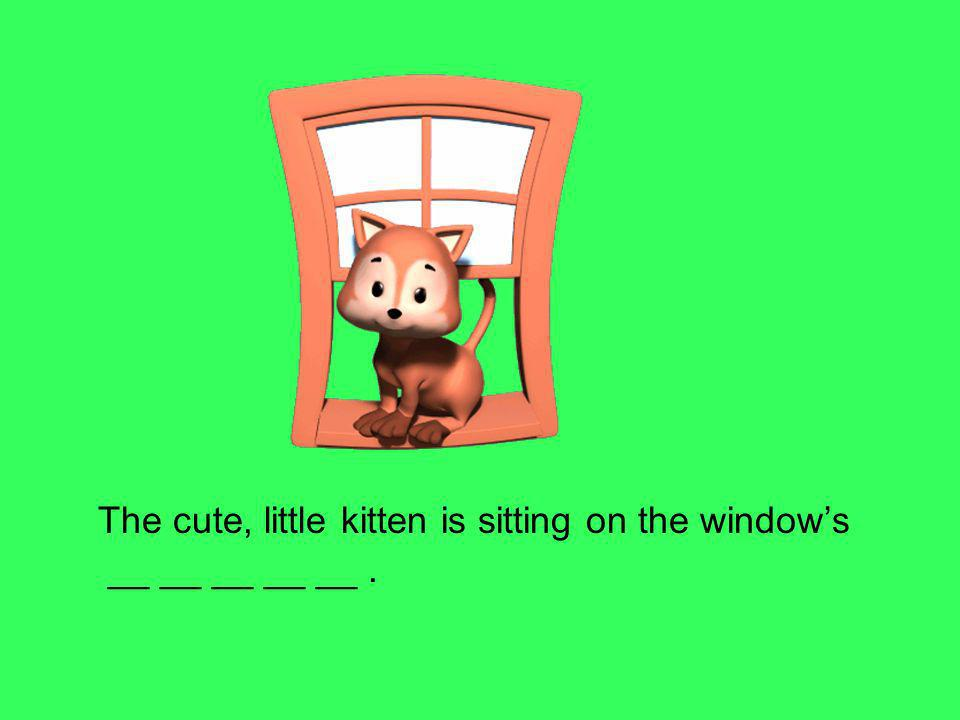 The cute, little kitten is sitting on the window's